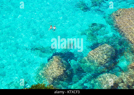 People swimming in the emerald waters of Cala Mitjana, Menorca, Balearic Islands, Spain, Mediterranean, Europe - Stock Photo