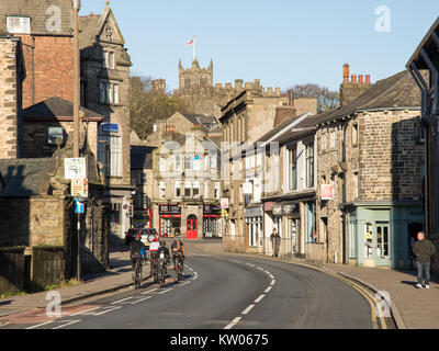 Lancaster, England, UK - November 12, 2017: A group of road cyclists ride past shops and houses on King Street in - Stock Photo