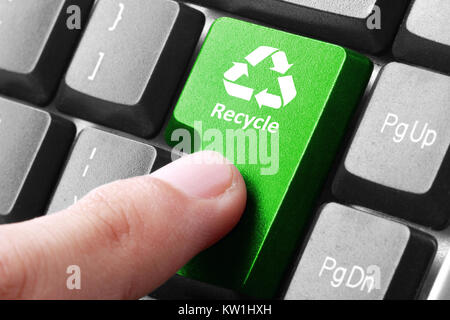 Green recycle button on the keyboard - Stock Photo