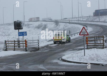 Saddleworth, UK. 29th Dec, 2017. Traffic Police parked at the side of Junction 22 of the  M62, Saddleworth, 29th - Stock Photo