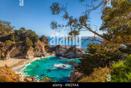 Classic postcard view of famous McWay Falls in scenic golden evening light at sunset, Pfeiffer Beach, Big Sur, California, - Stock Photo