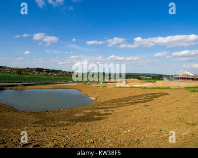 Waterlogged land being prepared for housing development, Grantham, Lincolnshire, England, UK. - Stock Photo