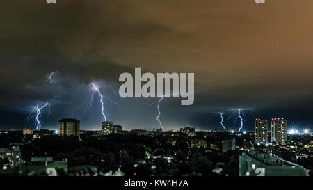 Lightning storm over city, thunderbolt - Stock Photo