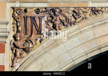 A close up of the flamboyant detailing on an archway spandrel on the London Road elevation of Leicester station. - Stock Photo