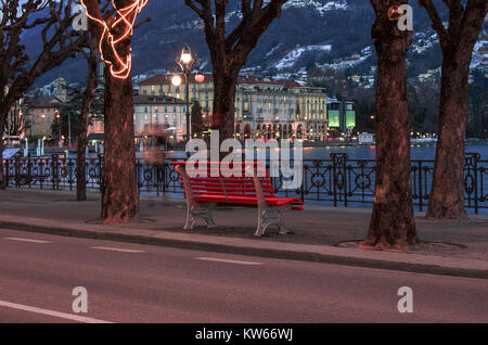 romantic lakeside of Lugano, Switzerland, from where to observe the lights of the city reflected on the water - Stock Photo