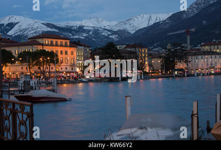 Lugano, Switzerland. a cold winter evening, with mountains covered in snow - Stock Photo