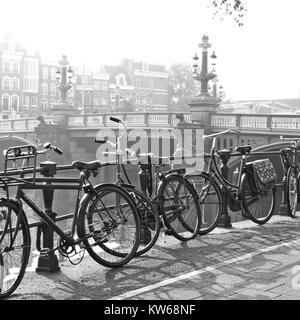 Old Amsterdam, bikes on bridge - Stock Photo