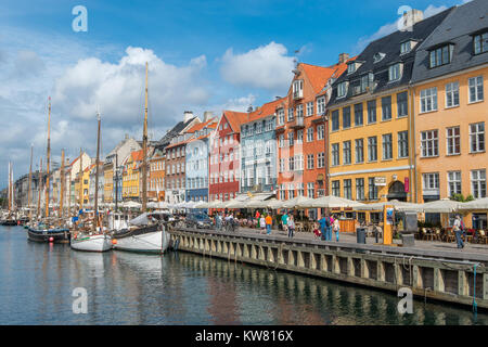 Nyhavn, a 17th century harbor district in the center of Copenhagen and currently a popular waterfront tourist attraction - Stock Photo