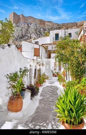 Acropolis and white houses in the Anafiotika quarter, neighborhood of Plaka, Athens, Greece - Stock Photo