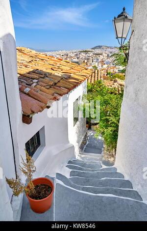 White wall houses in the Anafiotika quarter under the Acropolis, neighborhood of Plaka, Athens, Greece - Stock Photo