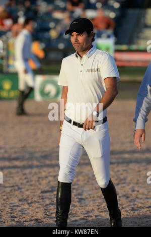 WELLINGTON, FL - MARCH 14: Andres Rodriguez participants in the $127,000 Horseware Ireland Grand Prix at the Winter - Stock Photo
