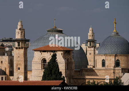 View of mosque minarets and dome of the Church of the Holy Sepulchre in the Christian Quarter. old city East Jerusalem - Stock Photo