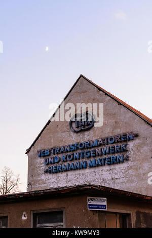old factory from GDR times sign 'VEB Transformatoren- und Röntgenwerk Hermann Matern, TuR' - Stock Photo