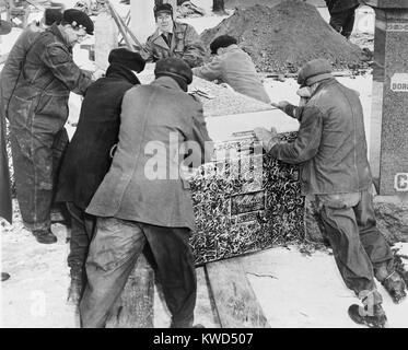 Burying Al Capone. Workmen at Mt. Olivet Cemetery in Chicago moving the vault with Al Capone's body. Feb. 6, 1947. - Stock Photo