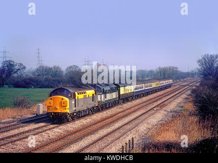 A pair of class 37 diesel locomotives numbers 37038 and 37197 working a relief service at Marshfield in south Wales. - Stock Photo