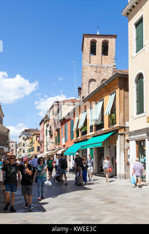 Busy street scene in Strada Nova, Cannaregio, Venice,  Veneto, Italy with Chiesa di Santa Sofia and pedestrians - Stock Photo