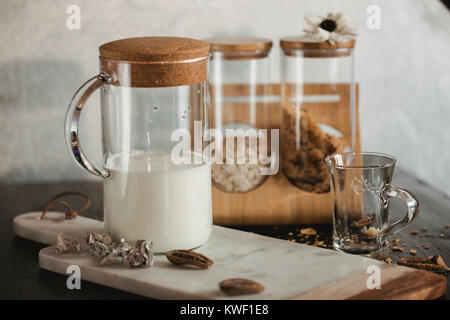 Flakes and cup of milk for breakfast. Concept of healthy food. Warm toning image. Rustic styling. - Stock Photo