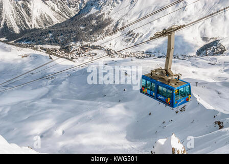 Arosa cablecar up to Weisshorn Peak at ski resort Arosa in winter, Switzerland - Stock Photo
