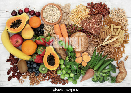 Food with high fiber content for a healthy diet with fruit, vegetables, whole wheat bread, pasta, nuts, legumes, - Stock Photo