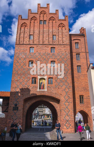 XIV century city gate called Upper Gate or High Gate in Olsztyn city in Warmian-Masurian Voivodeship of Poland - Stock Photo