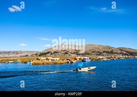 Titicaca is a large, deep lake in the Andes on the border of Peru and Bolivia - Stock Photo