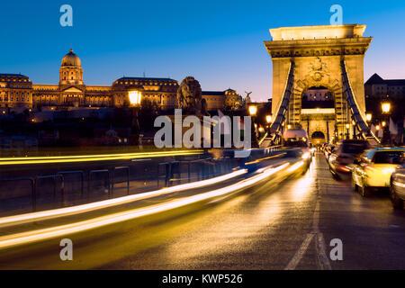 Evening traffic on Suspension Bridge in Budapest, Hungary, toned image - Stock Photo