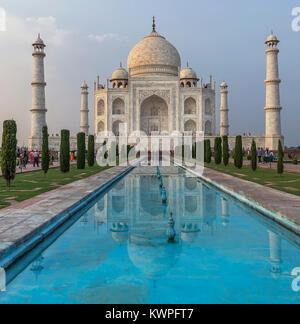 Taj Mahal and its reflection in the late afternoon light, Agra, Uttar Pradesh, India - Stock Photo