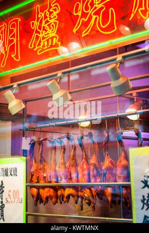 Roast Ducks hanging in Window of Retail Store in Chinatown, New York City, USA. - Stock Photo