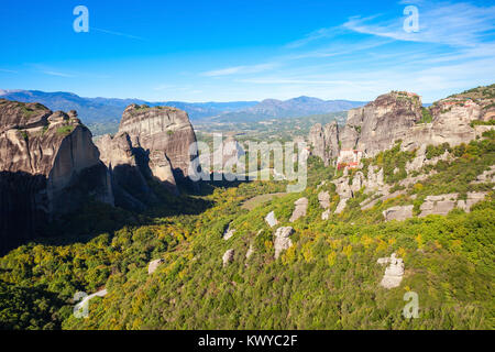 Meteora - is a formation of immense monolithic pillars and hills like huge rounded boulders which dominate the local - Stock Photo