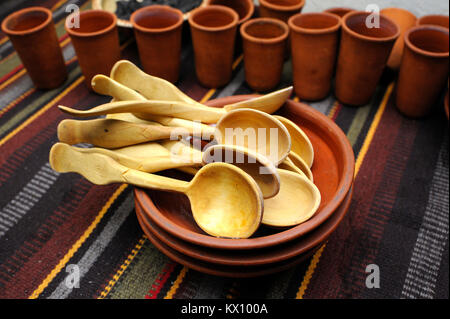 Traditional Ukrainian tableware – plates, wooden spoons and clay cups - placed on a bench. January 4,2018. Kiev, - Stock Photo