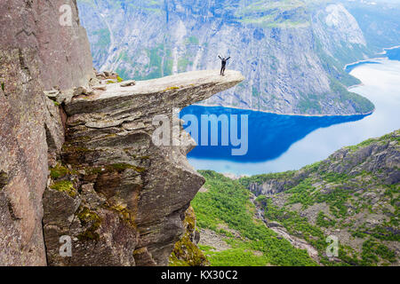 Trolltunga or Troll Tongue is a rock formation  at the Hardangerfjord near Odda town in Hordaland, Norway - Stock Photo
