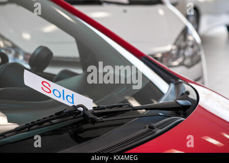 sold car in a showroom of a car dealer - Stock Photo