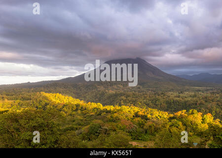 Volcano Arenal in clouds, Arenal Volcano National Park, Alajuela province, Costa Rica - Stock Photo