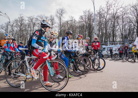 Gomel, Belarus - April 10, 2016: Young cyclists athletes prepare for a bike ride in Gomel on Lenin Square - Stock Photo