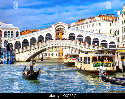 Colorful Rialto Bridge Public Ferries Vaporetto Ferry Docks Gondola Touirists Grand Canal Venice Italy - Stock Photo