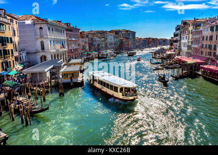 Colorful Grand Canal Public Ferries Vaporetto Ferry Docks Gondola From Rialto Bridge Touirists Grand Canal Venice - Stock Photo