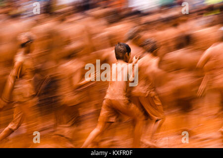 The most ridiculously fun and amusing mud bath, the monsoon festival of Chikal Kalo is celebrated only in Goa. - Stock Photo
