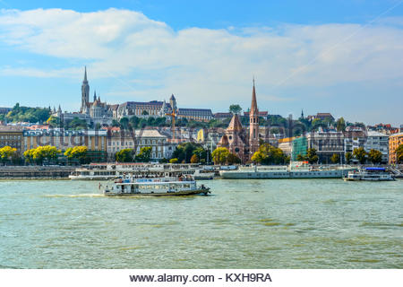 The Szilágyi Dezső Square Reformed Church on the banks of the Danube River in Budapest Hungary with the Castle District, - Stock Photo