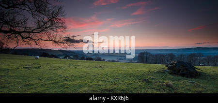 Winter sunset view from the South Downs near Old Winchester Hill - an Iron Age fort - towards Southampton - Stock Photo