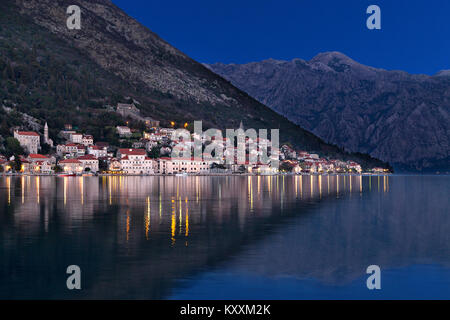 View over the village of Perast at night in Kotor bay, Adriatic Sea, Montenegro. - Stock Photo