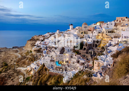 Oia village in Santorini, Greece, in in the evening - Stock Photo