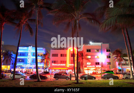 Ocean Drive Art Deco buildings illuminated at dusk in Miami Beach - Stock Photo