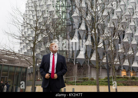 London, 12th January 2018: The waxwork of Donald Trump stands outside the US Embassy at Nine Elms in south London - Stock Photo