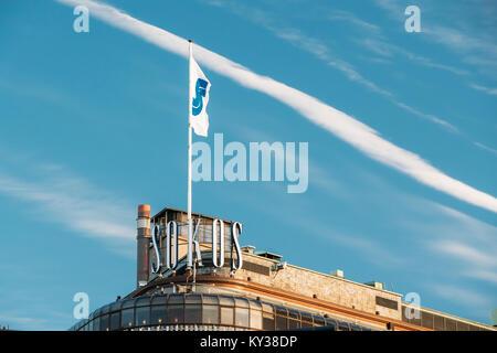 Helsinki, Finland - December 10, 2016: Flag With Logo Logotype On Roof Of Original Sokos Hotel On Background Blue - Stock Photo
