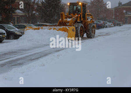 January 04 2018 NY New York: Snow-removing machine cleans the street of the city park from the snow in the morning - Stock Photo