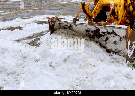 Snow-removing machine cleans the street of the city park from the snow in the morning snow-covered trees. Cleaning - Stock Photo