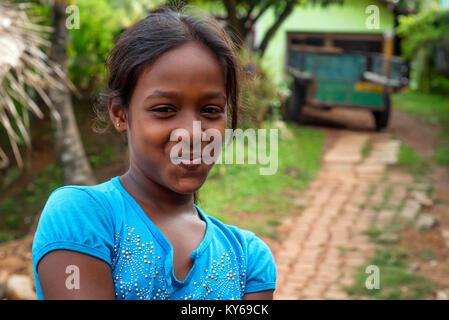 COLOMBO, SRI LANKA - CIRCA DECEMBER 2016: Portrait of smiling unidentified teenage girl - Stock Photo