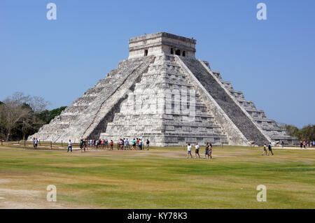 Pyramid Kukulkan and tourists on the square in Chichen Itza, Mexico - Stock Photo