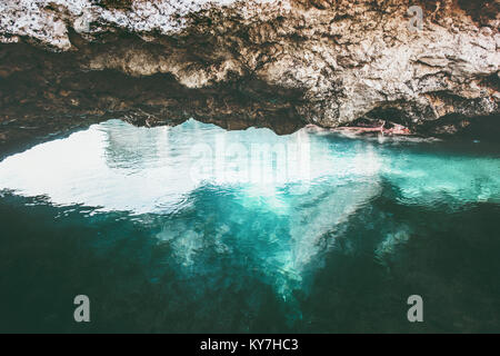 Blue Sea and rocky cave Landscape calm and tranquility scenic view vacations travel tropical island - Stock Photo