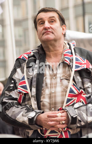 A BNP protester with Union Flags around his neck at the BNP 'No More Immigration' protest outside Lunar House, the - Stock Photo
